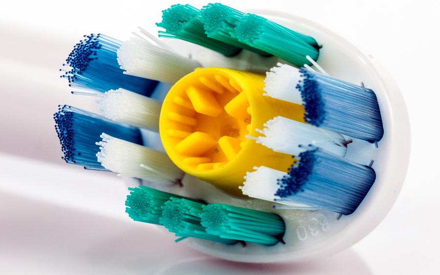 Como funciona uma escova de dente elétrica